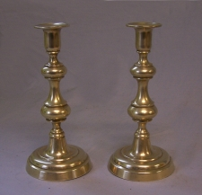 True pair of American brass push up candlesticks c1830