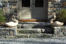 Large pair of hand carved swans by Kach