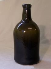 18thc hand blown glass American spirits bottle with pontil base c1730