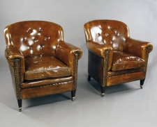 Matched pair of antique leather armchairs c1900