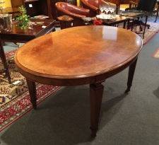 Antique English oval walnut dining table with satin wood inlay c1870