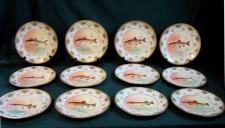 Set of twelve Limoges porcelain fish plates c1900